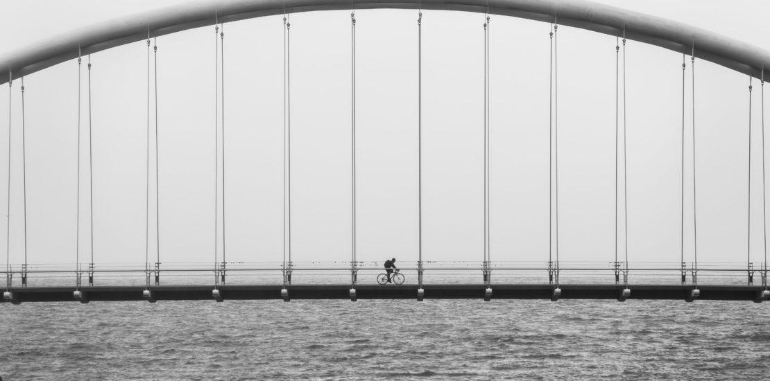 biking-over-bridge_4460x4460